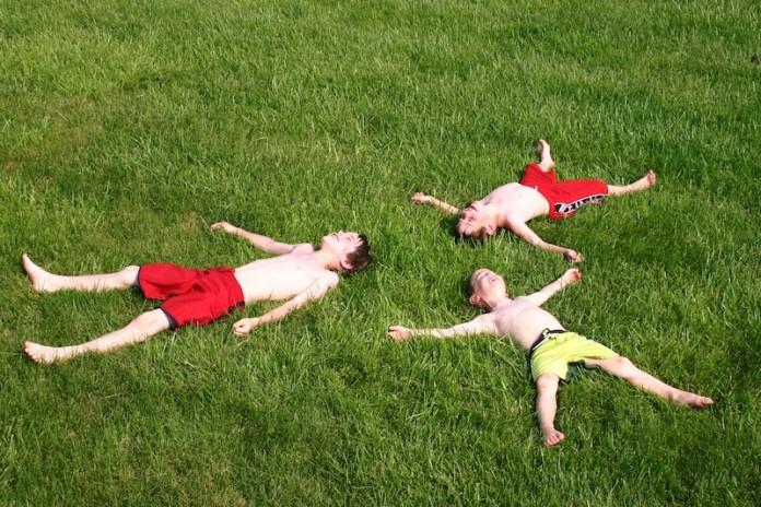 boys having fun in the grass